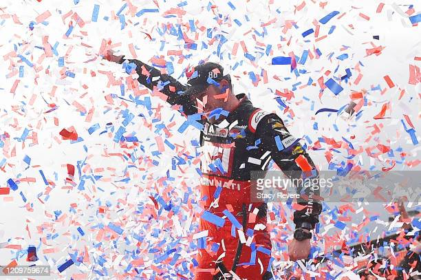 Alex Bowman driver of the Cincinnati Chevrolet celebrates in Victory Lane after winning the NASCAR Cup Series Auto Club 400 at Auto Club Speedway on...