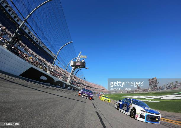 Alex Bowman driver of the Nationwide Chevrolet and Denny Hamlin driver of the FedEx Express Toyota lead the field prior to the start of the Monster...