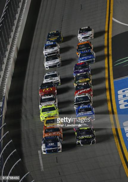 Alex Bowman driver of the Nationwide Chevrolet and Jimmie Johnson driver of the Lowe's for Pros Chevrolet lead the field to start the Monster Energy...