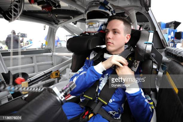 Alex Bowman driver of the Nationwide Chevrolet gets into his car during qualifying for the Monster Energy NASCAR Cup Series Toyota Owners 400 at...