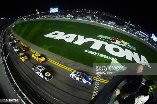 Alex Bowman driver of the Nationwide Chevrolet leads during the Monster Energy NASCAR Cup Series Gander RV Duel At DAYTONA at Daytona International...