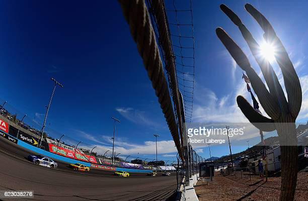 Alex Bowman driver of the Nationwide Chevrolet leads Joey Logano driver of the Shell Pennzoil Ford during the NASCAR Sprint Cup Series CanAm 500 at...