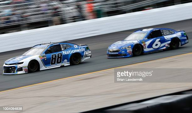 Alex Bowman driver of the Nationwide Chevrolet leads Matt Kenseth driver of the Constantine Sealing Service Ford during the Monster Energy NASCAR Cup...