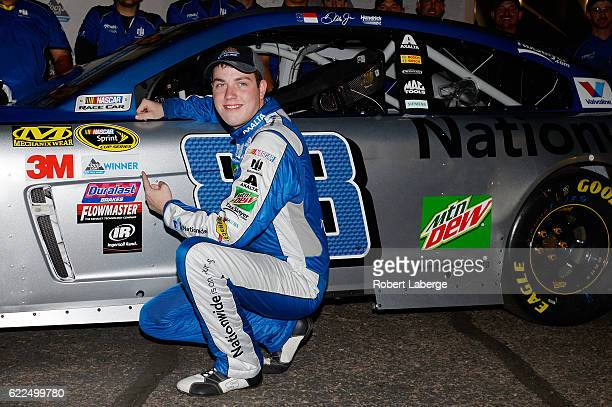 Alex Bowman driver of the Nationwide Chevrolet places the Coors Light Pole Award decal on his car after qualifying for the pole position for the...
