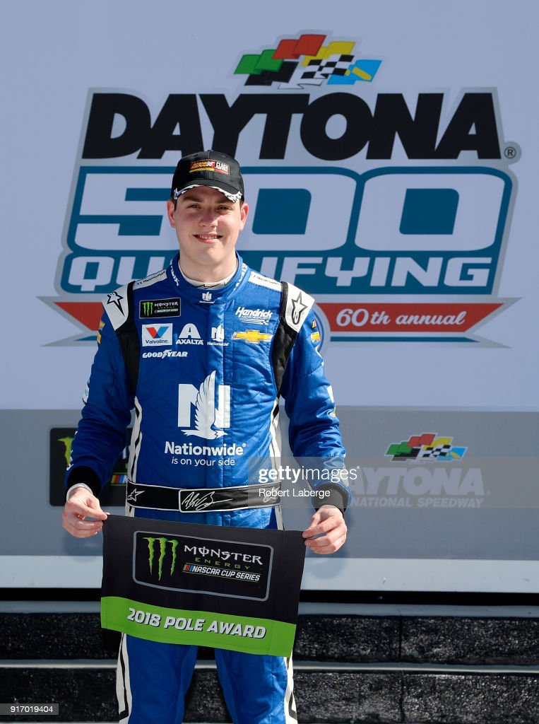 Alex Bowman, driver of the #88 Nationwide Chevrolet, poses for a photo after winning the Pole Award during qualifying for the Monster Energy NASCAR Cup Series Daytona 500 at Daytona International Speedway on February 11, 2018 in Daytona Beach, Florida.