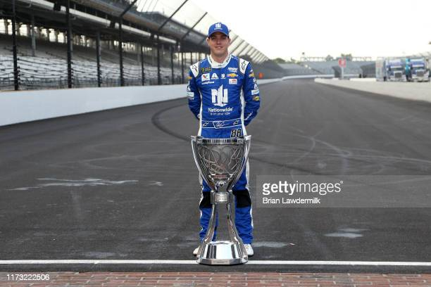 Alex Bowman driver of the Nationwide Chevrolet poses for a photo with the Monster Energy NASCAR Cup Series trophy to start the playoffs following the...