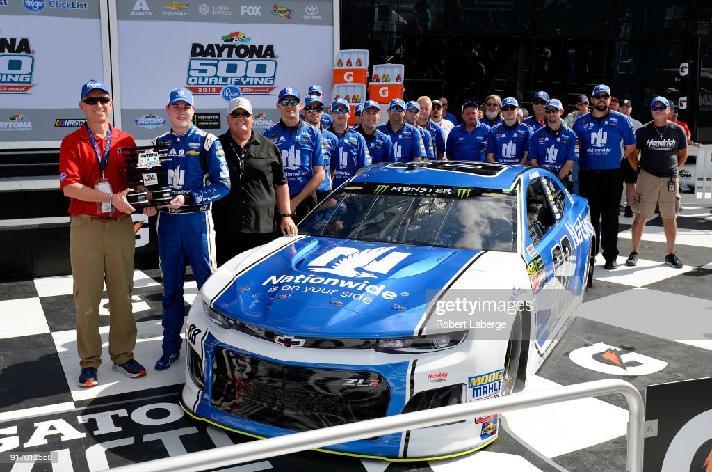 Alex Bowman, driver of the #88 Nationwide Chevrolet, poses with team owner Rick Hendrick, crew chief Greg Ives and crew members after winning the pole award during qualifying for the Monster Energy NASCAR Cup Series Daytona 500 at Daytona International Speedway on February 11, 2018 in Daytona Beach, Florida.