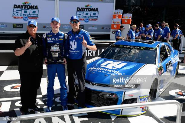 Alex Bowman driver of the Nationwide Chevrolet poses with team owner Rick Hendrick and crew chief Greg Ives after winning the pole award during...