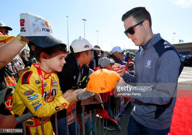 Alex Bowman driver of the Nationwide Chevrolet signs autographs on the red carpet before the driver's meeting before the Monster Energy NASCAR Cup...