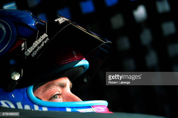 Alex Bowman driver of the Nationwide Chevrolet sits in his car during practice for the NASCAR Sprint Cup Series New Hampshire 301 at New Hampshire...