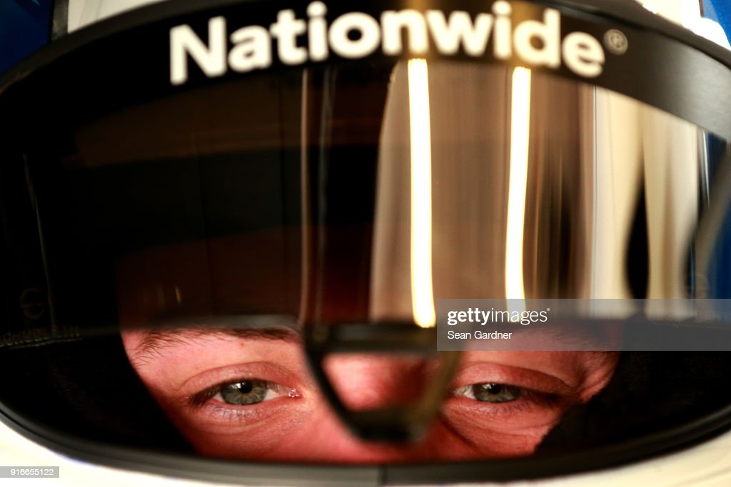Alex Bowman, driver of the #88 Nationwide Chevrolet, sits in his car during practice for the Monster Energy NASCAR Cup Series Daytona 500 at Daytona International Speedway on February 10, 2018 in Daytona Beach, Florida.