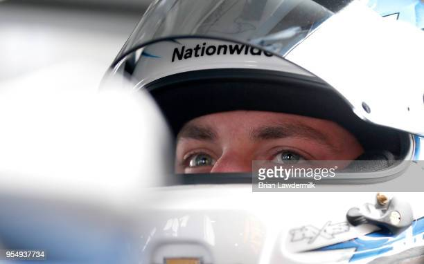 Alex Bowman driver of the Nationwide Chevrolet sits in his car during practice for the Monster Energy NASCAR Cup Series AAA 400 at Dover...