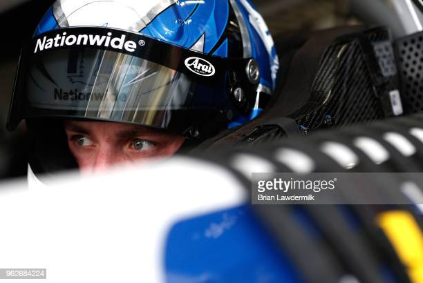 Alex Bowman driver of the Nationwide Chevrolet sits in his car during practice for the Monster Energy NASCAR Cup Series CocaCola 600 at Charlotte...