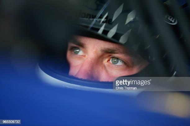 Alex Bowman driver of the Nationwide Chevrolet sits in his car during practice for the Monster Energy NASCAR Cup Series Pocono 400 at Pocono Raceway...