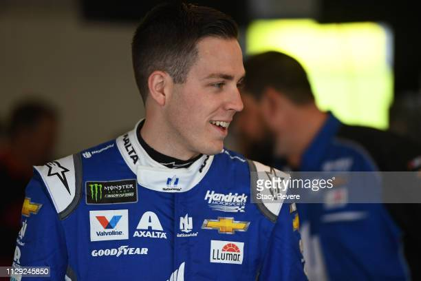 Alex Bowman driver of the Nationwide Chevrolet stands by his car during practice for the Monster Energy NASCAR Cup Series TicketGuardian 500 at ISM...
