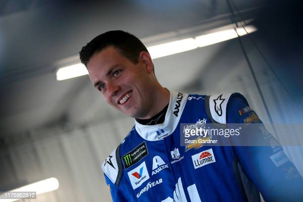Alex Bowman driver of the Nationwide Chevrolet stands in the garage during practice for the Monster Energy NASCAR Cup Series Federated Auto Parts 400...