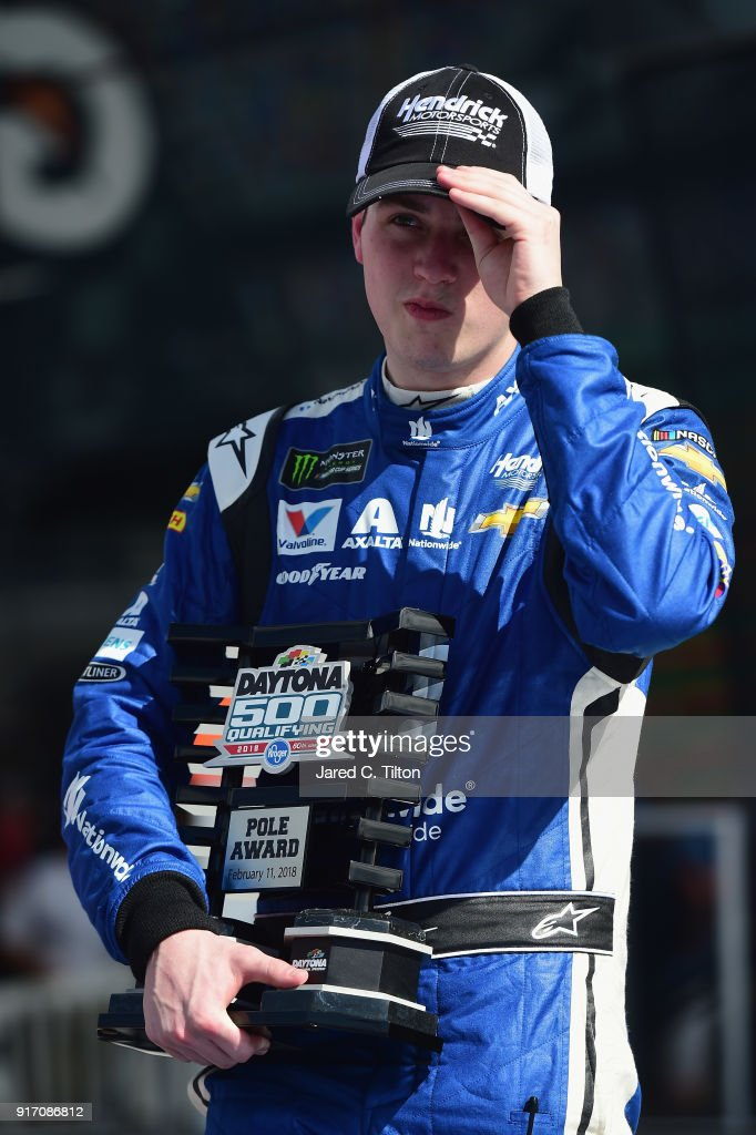 Alex Bowman, driver of the #88 Nationwide Chevrolet, stands in Victory Lane after winning the pole award for the Monster Energy NASCAR Cup Series Daytona 500 at Daytona International Speedway on February 11, 2018 in Daytona Beach, Florida.