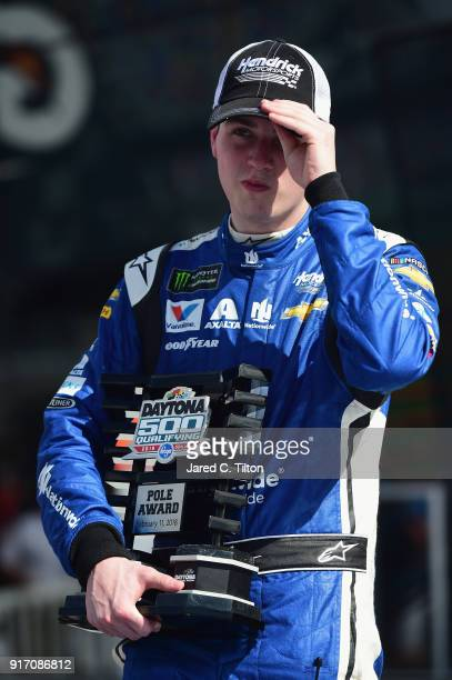 Alex Bowman driver of the Nationwide Chevrolet stands in Victory Lane after winning the pole award for the Monster Energy NASCAR Cup Series Daytona...