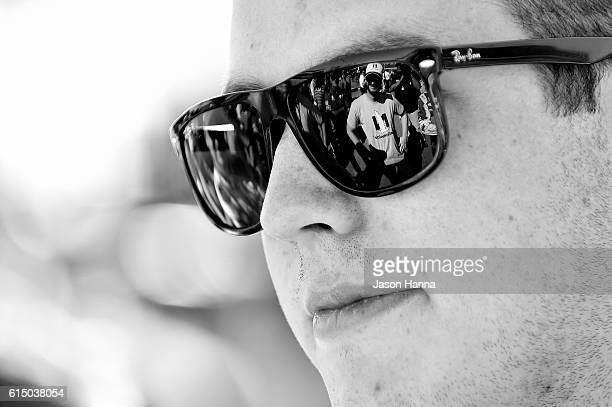 Alex Bowman driver of the Nationwide Chevrolet stands on the grid as a reflection of Dale Earnhardt Jr appears in his sunglasses prior to the NASCAR...
