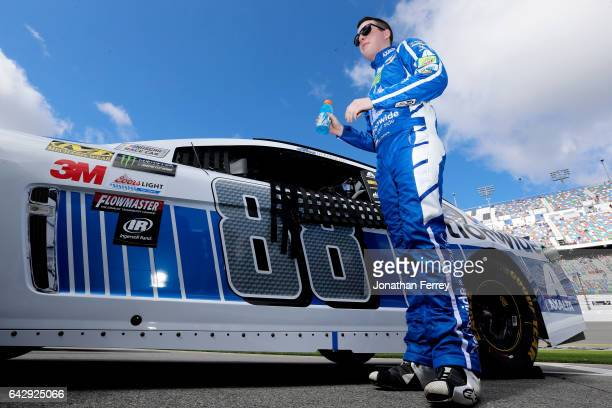 Alex Bowman driver of the Nationwide Chevrolet stands on the grid prior to the weather delayed Monster Energy NASCAR Cup Series Advance Auto Parts...