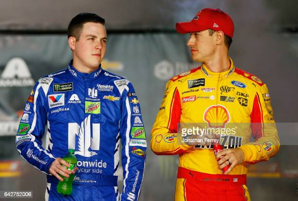 Alex Bowman driver of the Nationwide Chevrolet talks with Joey Logano driver of the Shell Pennzoil Ford during prerace festivities for the Monster...
