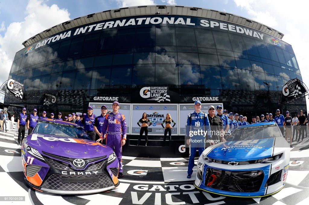 Alex Bowman, driver of the #88 Nationwide Chevrolet, team owner Rick Hendrick, Denny Hamlin, driver of the #11 FedEx Express Toyota, and crew members pose for a photo after winning the pole award during qualifying for the Monster Energy NASCAR Cup Series Daytona 500 at Daytona International Speedway on February 11, 2018 in Daytona Beach, Florida.