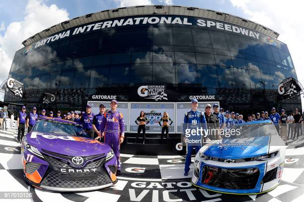Alex Bowman driver of the Nationwide Chevrolet team owner Rick Hendrick Denny Hamlin driver of the FedEx Express Toyota and crew members pose for a...