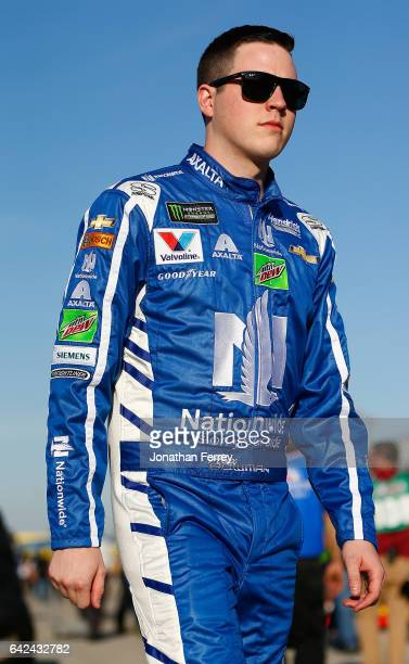 Alex Bowman driver of the Nationwide Chevrolet walks the garage area during practice for the Monster Energy NASCAR Cup Series Advance Auto Parts...