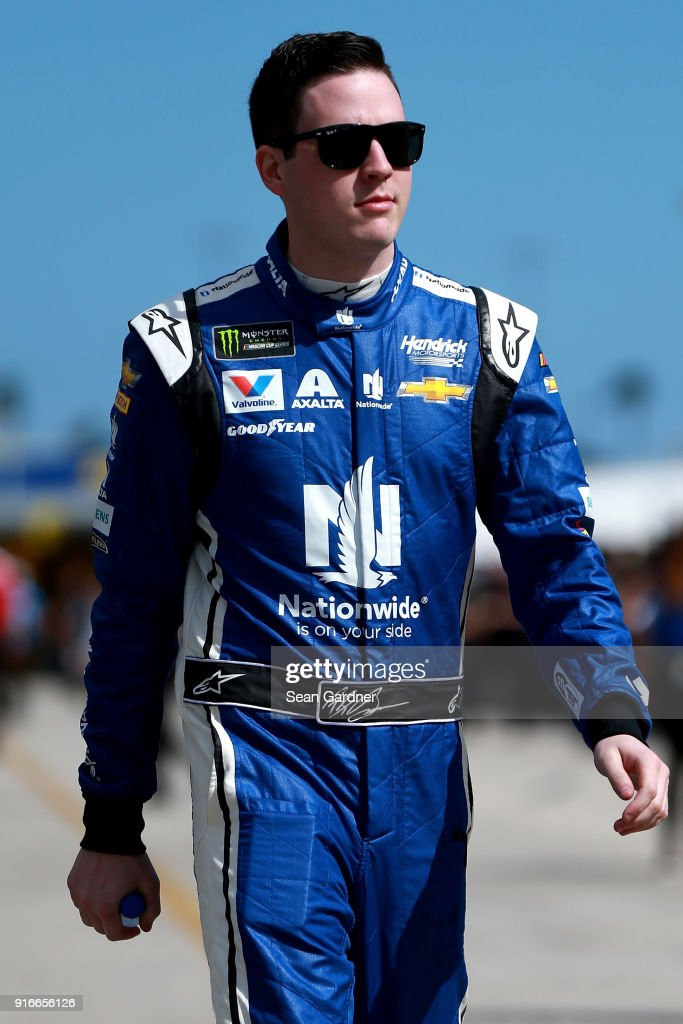 Alex Bowman, driver of the #88 Nationwide Chevrolet, walks to his car during practice for the Monster Energy NASCAR Cup Series Daytona 500 at Daytona International Speedway on February 10, 2018 in Daytona Beach, Florida.