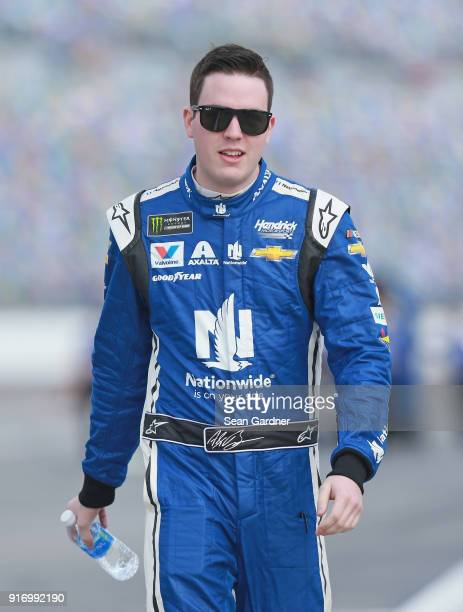 Alex Bowman driver of the Nationwide Chevrolet walks to his car during qualifying for the Monster Energy NASCAR Cup Series Daytona 500 at Daytona...
