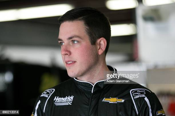 Alex Bowman driver of the Nationwide Insurance Chevrolet looks on during testing for the Monster Energy NASCAR Cup Series at New Hampshire Motor...