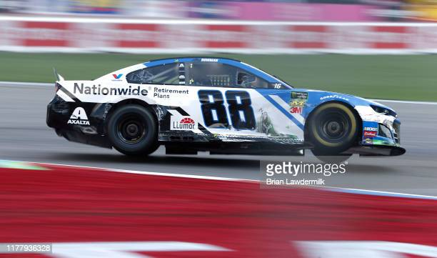 Alex Bowman driver of the Nationwide Retirement Plans Chevrolet races during the Monster Energy NASCAR Cup Series Bank of America ROVAL 400 at...