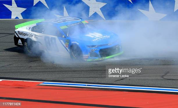 Alex Bowman driver of the Nationwide Retirement Plans Chevrolet spins out during the Monster Energy NASCAR Cup Series Bank of America ROVAL 400 at...
