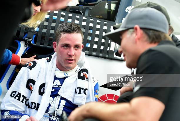 Alex Bowman driver of the Nationwide Retirement Plans Chevrolet speaks with NASCAR Hall of Famer Jeff Gordon following the Monster Energy NASCAR Cup...