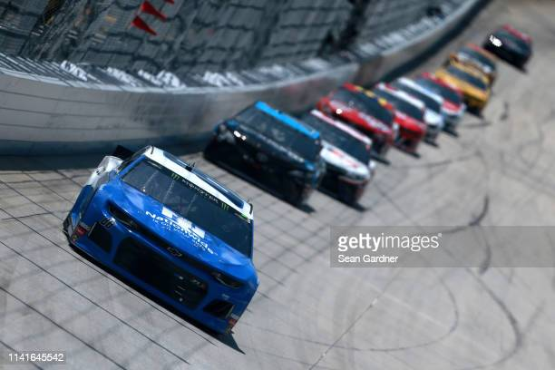 Alex Bowman driver of the Nationwide Small Business Chevrolet leads a pack of cars during the Monster Energy NASCAR Cup Series Gander RV 400 at Dover...