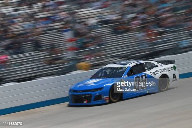 Alex Bowman driver of the Nationwide Small Business Chevrolet races during the Monster Energy NASCAR Cup Series Gander RV 400 at Dover International...