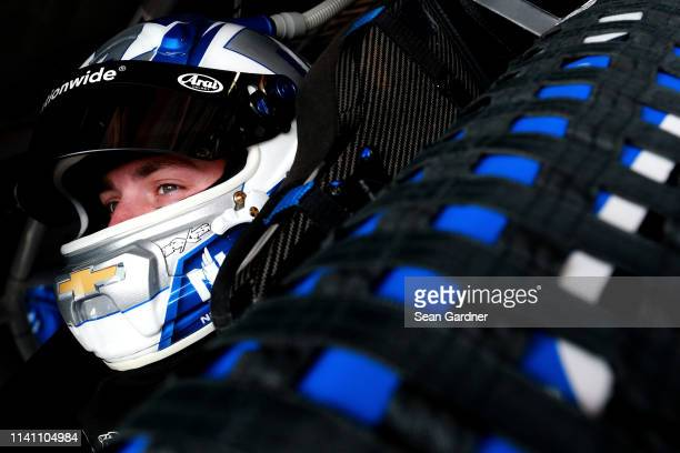 Alex Bowman driver of the Nationwide Small Business Chevrolet sits in his car during practice for the Monster Energy NASCAR Cup Series Gander RV 400...