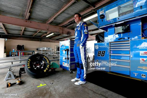 Alex Bowman driver of the Nationwide Small Business Chevrolet stands during practice for the Monster Energy NASCAR Cup Series Gander RV 400 at Dover...