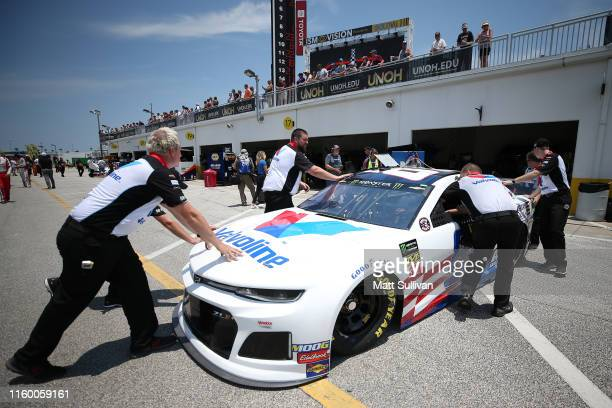 Alex Bowman driver of the Valvoline Patriotic Chevrolet has his car pushed through the garage area during practice for the Monster Energy NASCAR Cup...