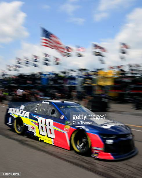 Alex Bowman drives the Axalta Chevrolet through the garage area during practice for the Monster Energy NASCAR Cup Series Pocono 400 at Pocono Raceway...