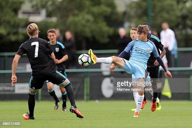 Alex Bradley of West Bromwich Albion U18 and Iker Pozo of Manchester City U18 during the U18 Premier League match between Manchester City and West...