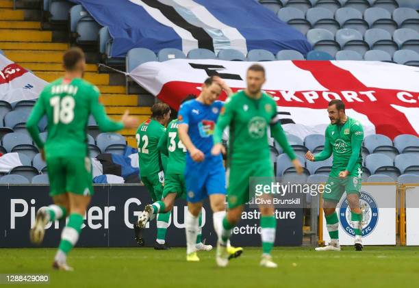 Alex Bradley of Yeovil Town celebrates after scoring their sides second goal during the Emirates FA Cup Second Round match between Stockport County...
