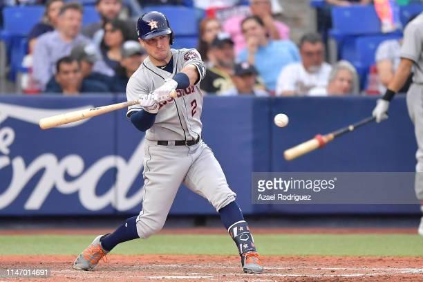 Alex Bregman, #2 of the Houston Astros, connects a hit on the fifth inning of the Houston Astros vs Los Angeles Angels of Anaheim match at Estadio de...