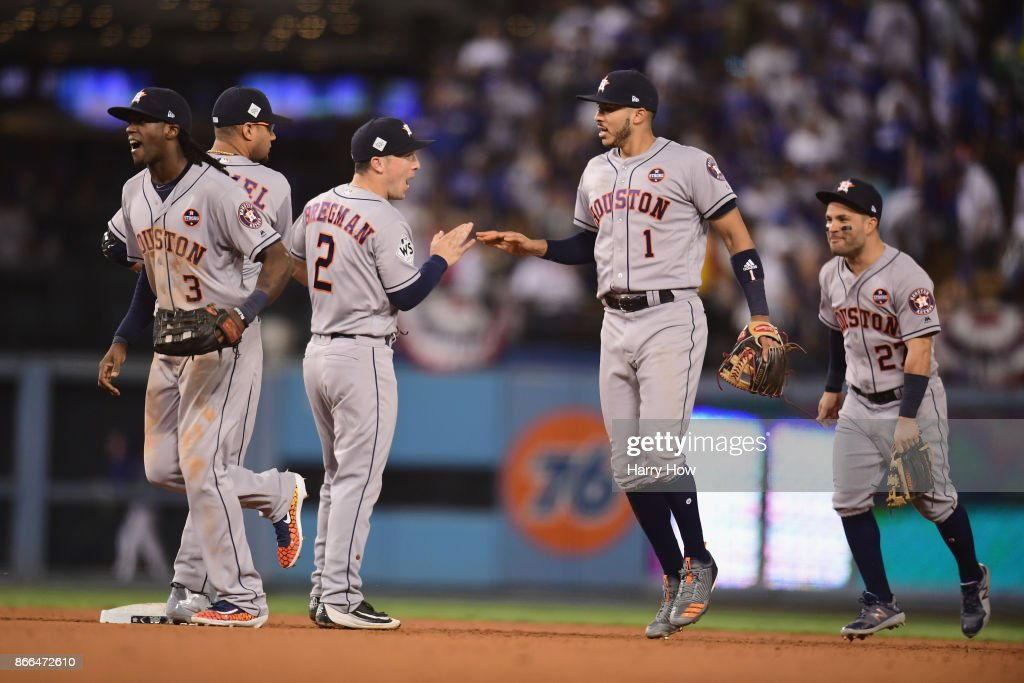 Alex Bregman #2 and Carlos Correa #1 of the Houston Astros celebrate defeating the Los Angeles Dodgers 7-6 in eleven innings to win game two of the 2017 World Series at Dodger Stadium on October 25, 2017 in Los Angeles, California.