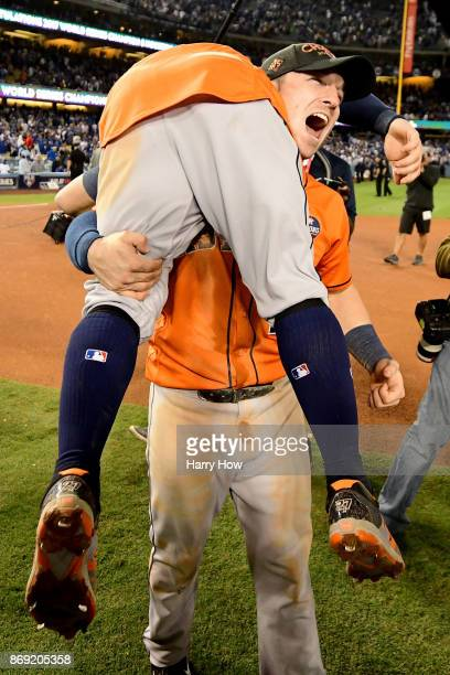 Alex Bregman and Jose Altuve of the Houston Astros celebrate after defeating the Los Angeles Dodgers 51 in game seven to win the 2017 World Series at...