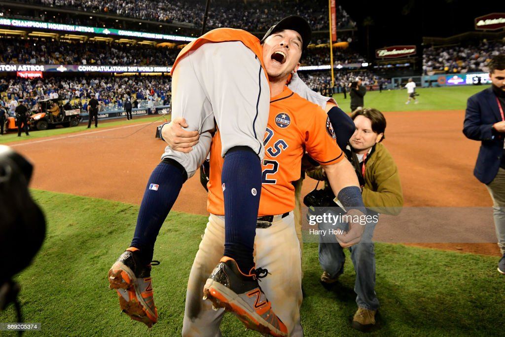 Alex Bregman #2 and Jose Altuve #27 of the Houston Astros celebrate after defeating the Los Angeles Dodgers 5-1 in game seven to win the 2017 World Series at Dodger Stadium on November 1, 2017 in Los Angeles, California.