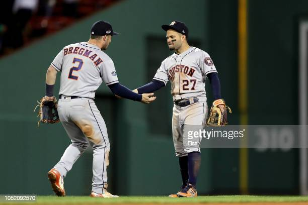 Alex Bregman and Jose Altuve of the Houston Astros celebrate their team's win over the Boston Red Sox in Game One of the American League Championship...