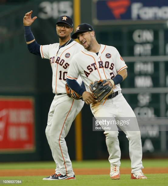 Alex Bregman and Yuli Gurriel of the Houston Astros celebrate a 41 win over the Minnesota Twins at Minute Maid Park on September 3 2018 in Houston...