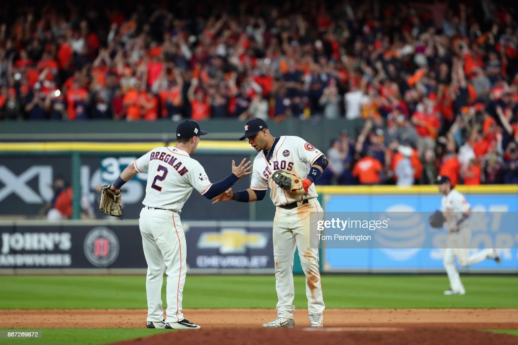 Alex Bregman #2 and Yuli Gurriel #10 of the Houston Astros celebrate after defeating the Los Angeles Dodgers in game three of the 2017 World Series at Minute Maid Park on October 27, 2017 in Houston, Texas. The Astros defeated the Dodgers 5-3.