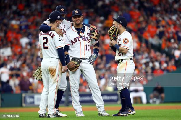 Alex Bregman Carlos Correa Yuli Gurriel and Jose Altuve of the Houston Astros joke around during a pitching change during Game 5 of the 2017 World...